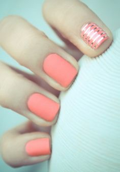 Light coral nails with silver striped accent nail