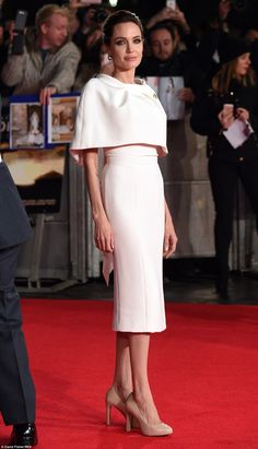 Demure: The petite star seemed almost flawlessly dressed in appropriate muted colours for the film premiere