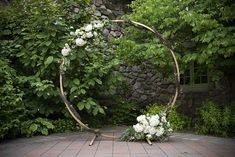 Summer/ fall ceremony arbor inspiration - gold circular arbor, white flowers, greenery, angel vine garland. Willowdale Estate, a weddings and events venue in New England. WillowdaleEstate.com | Thomson and Thomson Photo