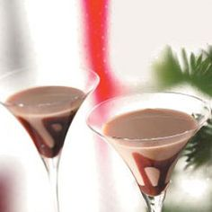 Caramel Vanilla Martini (•Ice cubes  •3 ounces Amaretto  •2 ounces caramel-flavored Irish cream liqueur  •1-1/2 teaspoons vanilla vodka  •Chocolate syrup)