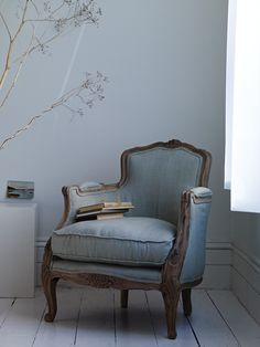 French-style hand-carved wooden chair, upholstered with 100% linen in a beautiful shade of eau-de-nil..