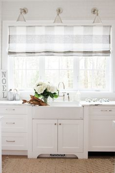 This large scale Schumacher Buffalo Check was the perfect way to dress this kitchen window.  Buy online in your own custom size!  https://qdesigncentre.com/shop/shades/monika-hibbs-buffalo-check-shade/