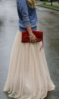 Very cool outfit.  Nude maxi skirtt and denim jacket. Perfect match