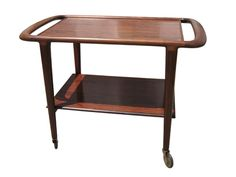 Designed by H. Klein for renowned Danish department store Illums Boligus, this lovely serving cart features a solid rosewood frame with curved edges and a highly practical rosewood-patterned laminate top and lower shelf. Portland Library, Vintage Furniture, Modern Furniture, Serving Cart, Low Shelves, Shelf, Machine Age, Department Store, New England