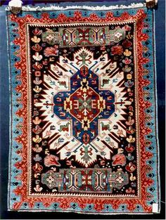 """Sunburst Zejwa Rug, Caucasus, 19th Century. - 3'-4"""" x 4'-6"""". This is an Antique Sunburst Zejwa. In the trade it is common to call this type of rug a Kazak but that is a misnomer. The exception to this is in the corrosive brown field where the has had expert repair. This is a very pretty rug with a bold powerful design. The border & some of the field icons are clearly influenced by Sejshour Kuba rugs. It is my feeling that this sunburst design is derivative of sixteenth century blossom…"""