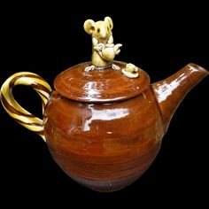 http://www.ebay.co.uk/itm/Treacle-Glaze-Teapot-with-Mouse-Finial-David-Cleverly-Haytown-Studio-Pottery-/122169827451?hash=item1c71e3a07b:g:kzsAAOSw8w1X4Wb5