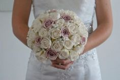 This tightly packed bridal posy contains ivory and lavender real touch rose buds with babies breath through out Fake Wedding Flowers, Flower Bouquet Wedding, Lilac, Lavender, Purple, Wedding Themes, Wedding Dresses, Wedding Ideas, Babies Breath