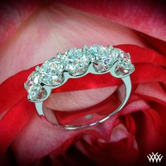 The epitome of style, the 'Skye' Five Stone U-Prong Diamond Right Hand Ring begs to be seen. The U-Shaped prongs show off the 5 diamonds of your choice from every angle.