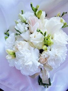 wedding bouquet, freesia, eustoma, carnations, roses, cream and white wedding bouquet