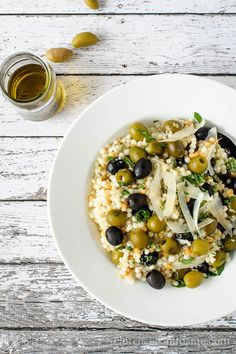Olive Couscous Salad. From the olives tossed into the salad to the olive oil, this picture makes clear what dish it is featuring. Design should never upstage the food.