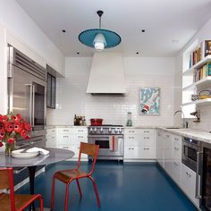 Blue painted kitchen floor #colorkitchen