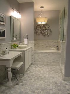 """I love this design! A great vanity solution: small vessel vanity and then vanity """"table"""" slightly lower than the height of the vessel vanity; both dark gray or white. In addition, beautiful grays throughout the room."""