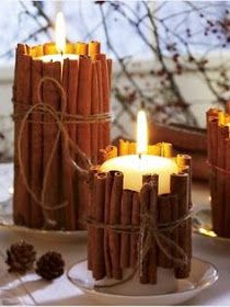 pretty Holiday decoration with candles surrender by cinnamon sticks