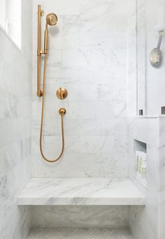 Lower niche, deep bench, brass hand shower, marble & EHD Rethinking the Shower Niche Rethinking the Shower Niche (& Why I Think The Ledge Is& The post Rethinking the Shower Niche (& Why I Think The Ledge Is & appeared first on Rees Home Decor. Marble Tile Bathroom, Master Bathroom Shower, Modern Bathroom, Small Bathrooms, Bathroom Images, Bathroom Sets, White Bathroom, Tile Shower Niche, Brass Bathroom Fixtures