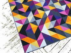 Fantastic colors in this HST quilt by Nadine of This Creative Bliss.