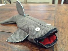 Shark pencil case - I found the inspiration for it here: http://www.patchworkposse.com/2014/08/shark-pencil-case-tutorial/  However, I sewed it slightly differently:  I started with the zipper and closed the sides afterwards.  I left the bottom of the lining open until the very end and simply serged across it for a much easier closure than in the tutorial.