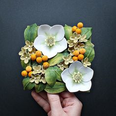 Floral Tile III - Spring Greenery. 🌿 The third of a series of densely packed 12cm*12cm #floral #tiles, this time with white #hellebore. #paperart #paperquilling #handmade #paperflowers #botanical #helleborus #strictlypaperart #lgenpaper