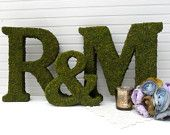 Moss-covered letters. Can get moss sheets at craft stores