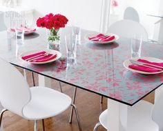 Use wallpaper under a glass table for a more stylish look!