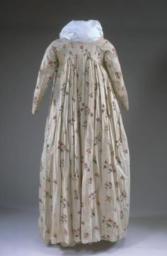Printed cotton dress (back), probably American (fabric made in India or England), 1790s. This gown, with its open robe and matching petticoat, is a product of the revival of Greek design in fashionable architecture, furniture, and clothing. The gown shown here opens in the front, which is not as common as back closures.