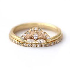 This marquise diamond petal stacking set — $1,870   19 Stunning Stacked Wedding Ring Sets You'll Say Yes To