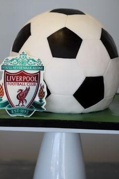 Looks amazing...we'll see if I can accomplish something similar in August. http://www.mysweetandsaucy.com/tag/liverpool-soccer-ball-cake/