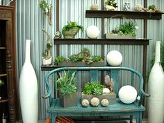 for indoor garden effect, try placing succulent arrangements on shelves and interspersing them with decor items, such as vases and deco balls  (from Big Red Sun via decoist)
