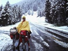 Doug Siple holding photographer Ron McClure's bike in West Yellowstone. About half a month into our Bikecentennial76 Trans-Am ride. This was the last snow we would see on the trip.  photo: Ron McClure