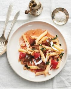Penne with Tomatoes and Parsley Breadcrumbs - For a weeknight, start the tomatoes marinating in olive oil and garlic before you go to work. When you get home, all that's left is to toast the breadcrumbs and grate the cheese while the pasta boils.