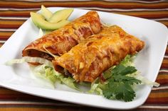 This Easy Beef Enchiladas recipe has diced zucchini hidden inside. It's topped with homemade enchilada sauce and lots of shredded cheese. Photos included.