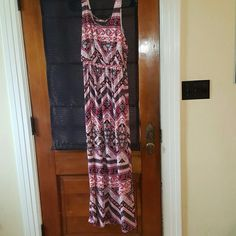 Floral and Chevron Print Maxi Dress Red, pink, white, cream, and black floral and chevron print maxi dress. Elastic waist. Criss-cross back opening. Never worn, tags still attached. Perfect condition. Maurices Dresses Maxi