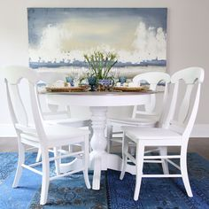 Table and chairs refinished in General Finishes Snow White milk paint. By Green Spruce Designs