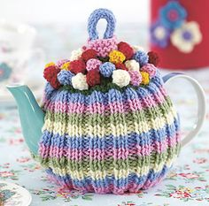 1 x ball of King Cole Merino Blend DK wool) in each of Pale Pink Pale Blue Aran Sage and Fern small amounts in each of Scarlet Gold and Pink Tea Cosy Knitting Pattern, Tea Cosy Pattern, Knitting Patterns, Knitting Projects, Crochet Projects, Teapot Cover, Knitted Tea Cosies, Tea Cozy, Sweet Tea