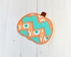 I adore these soft colors and the combination is just too sweet. https://www.hootyappliques.com/listing/568207987/coral-and-teal-chevron-pumpkin-fabric