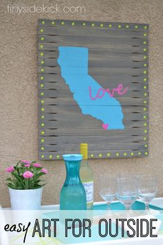 "California Love Outdoor Art (made from paint sticks) | I'm on a strict zero dollars is best budget when it comes to wall art, especially when it will be outside so here's what I came up with…I like to call my ""California Love Paint Stick Wall Art."""