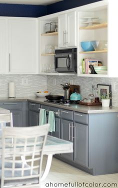 Painted Two Tone Kitchen Cabinets. White Uppers and Gray Lowers. Benjamin Moore Simply White, Benjamin Moore Anchor Gray