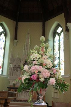we included Pom Poms of White Alliums with upwardly striving White Delphiniums and pink Larkspur, Pink Peonies and Hydrangeas Church Wedding Flowers, Altar Flowers, Church Flower Arrangements, Church Wedding Decorations, Wedding Flower Arrangements, Bridal Flowers, Church Weddings, Funeral Flowers, Wedding Ceremony