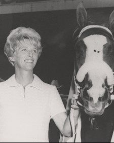 "Harriet always said, ""The studs are my business; the mares are my heart."" Harriett Peckham is remembered as the First Lady of Quarter Horse racing. She and her husband owned three Hall of Fame horses, one of them being Go Man Go. Harriet revolutionized the industry's emphasis on broodmare care. Harriet was inducted into the AQHA Hall of Fame and is featured in the Bold and Beautiful art exhibit at the AQHA Museum in Amarillo, Texas."