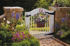 Floral Basket Gate - Choose the Perfect Garden Gate - Southernliving. A pretty basket overflowing with fresh blooms give this garden gate a true cottage feel. See more of this Atlanta Cottage Garden Garden Entrance, Entrance Gates, Garden Gates, Front Gates, Garden Beds, Garden Cottage, Home And Garden, Fence Gate, Dog Fence