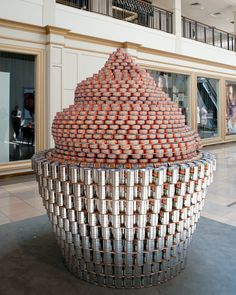 Lookes like it's made from pop cans and tuna cans. I have always wanted to do this! Food Sculpture, Sculptures, Canned Food Drive, Vancouver Food, Candy Decorations, Pop Cans, Park Art, Outdoor Art, Art And Architecture