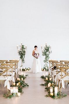 A stylish modern meets rustic wedding aisle with greenery, candles and chairs accented with elegant white ribbon bows. A stylish modern meets rustic wedding aisle with greenery, candles and chairs accented with elegant white ribbon bows. Wedding Ceremony Ideas, Indoor Wedding Ceremonies, Wedding Aisle Decorations, Wedding Altars, Chapel Wedding, Wedding Church, Wedding Aisle Candles, Wedding Events, Wedding Table