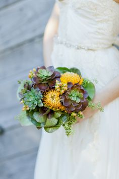 Go green at a garden wedding with an arrangement made from fresh succulents.  Photo by  Andi Mans via Style Me Pretty