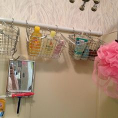 Shower organization; may do this with baskets, curtain loops, and other shower curtain bar... DID this- good storage solution keeps out of the kids reach- BUT reduces amount of head room.