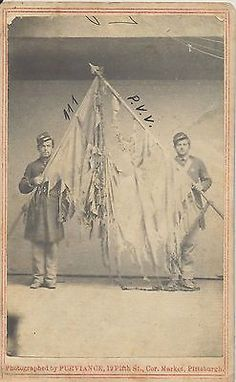 Outstanding CDV of two Union veteran soldiers proudly holding the battled and tattered colors from the 111th Pennsylvania Volunteers. The PV participated in some of the wars largest battles, including Antietam, Chancellorsville, Rappahannock Station, Lookout Mountain and Gettysburg. Civil War Flags, American History, American Pride, Lookout Mountain, War Image, America Civil War, Civil War Photos, Gettysburg, Civilization