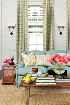 Nashville Idea House Tour | To find coffee tables of the right size and scale, Phoebe used a decorator's secret: She started with antique dining tables and had the legs cut down to make them the ideal height. #homeideas #southernliving #curbappeal #porchdecor