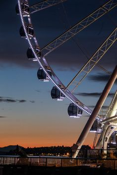 SEATTLE'S TOP 10 ATTRACTIONS - Seattle's Great Wheel ride is a popular new waterfront attraction. (Dean Rutz / The Seattle Times)