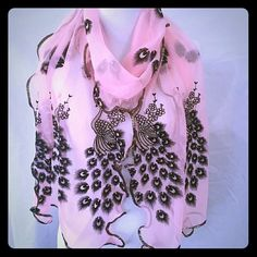 New Beautiful Peacock Scarf Peach Beautiful peach colored sheer background with gold and black peacock detailing throughout.  Very stunning. 14 inches wide and an incredible 78 inches long equates to someone that is 6'6. Accessories Scarves & Wraps