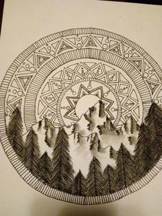 I used sharpie for the sun-like-mandala part and then i used a charcoal pencil for the trees and mountains