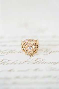 Round Center + Gold Victorian Lace Band   - HarpersBAZAAR.com