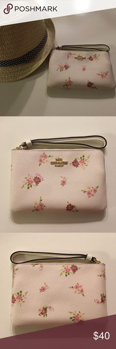 """🆕 COACH wristlet with floral print 💐 COACH wristlet (valued at $75)! Comes with brown gift box (pictured)  - Two credit card slots - Zip-top closure, fabric lining - Wrist strap not detachable  - 6 1/4"""" (L) x 4"""" (H) - Fits most phone sizes (note: fits iPhone X cozily, as long as the phone's case isn't too thick) - Color: IM/ Chalk Multi (off-white w/ various pink flowers, gold-colored Coach logo & hardware) Coach Bags Clutches & Wristlets"""